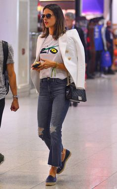 Alessandra Ambrosio from The Big Picture: Today's Hot Pics  The model is ready to take Rio de Janeiro back home with her by wearing a signature T-shirt through the airport.