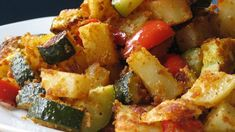 Lightly seasoned potatoes, zucchini, and red bell pepper are baked together in this easy side dish.
