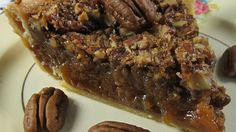 Corn syrup and brown sugar do magical things in this simple pecan pie that bakes up rich, gooey and delicious. The filling is stirred up, poured into an uncooked pie shell, sprinkled with pecans and baked.