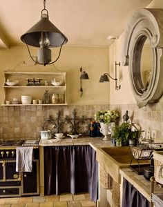 40 Beautiful European Country Kitchens {Decor Inspiration} - Hello Lovely French country kitchen with skirted lower cabinets and dramatic mirror above stone backsplash. Cocina Shabby Chic, Shabby Chic Kitchen, Farmhouse Kitchen Decor, Vintage Kitchen, Romantic Kitchen, Country Kitchen Designs, French Country Kitchens, French Cottage, French Country House