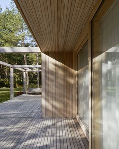 The roof's overhang also employs paneled Siberian larch. #swedish #sweden #retreat #scandinavian #outdoor #porch #deck