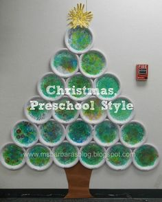 For the Children: Christmas, Preschool Style. What an awesome holiday classroom! Love all the additions to the housekeeping corner. Or use cupcake holders so one child can make entire tree Kids Crafts, Preschool Christmas Crafts, Classroom Crafts, Christmas Projects, Preschool Crafts, Holiday Crafts, Holiday Tree, Xmas Tree, Preschool Bulletin