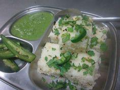 Gujarati White Dhokla           Rice - 1 cup Urad Dal - 1/4 cup Baking Soda - 1/4 tsp Lemon Juice - 1 tsp Peppercorns - 1/2 tsp Cumin Seeds - 1/2 tsp Red Chilli Powder - 1/2 tsp Coriander Leaves - few, chopped Oil - 1/4 cup Salt as per taste