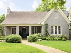 Painted brick ranch style Tudor... Nice colour of gray.