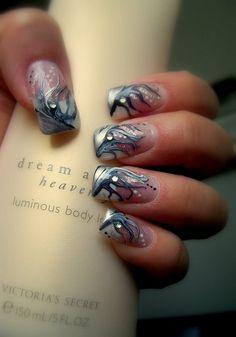 Beautiful nail art design.. looks like glittery flames