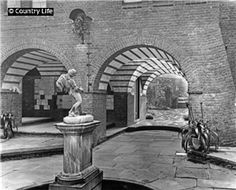 The fountain court at Deanery Garden, built by Sir Edwin Lutyens between 1899 and 1901 for Edward Hudson. Pub