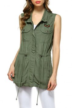 Green military vest with front zipper decorative patch pockets and adjustable waist. Military Zip Vest by Skies Are Blue. Clothing - Jackets Coats & Blazers - Vests Texas