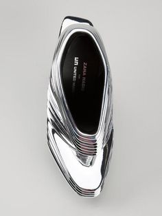 The limited edition haute couture shoe NOVA in SILVER is a collaboration of Hadid and Rem D Koolhaas of United Nude. A design statement that combines innovative