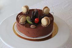 chocolate moussecake with chocolate ganache macarons on top  Onnellinenkirsikka.fi