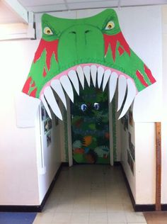 This is a little on the scary side, but I like the idea of just the top part of the doorway/hallway being decoration in the dinosaur classroom theme.
