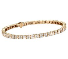 This tennis bracelet features a unique pattern comprised of round, princess, and baguette cut diamonds set in 14k yellow gold.