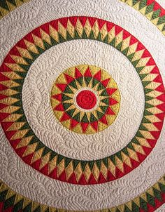 Detail, Bulls eye quilt with Mariner's Compass, c. 1860, photographed at the Rocky Mountain Quilt Museum (Colorado)