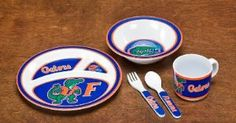 NCAA Florida Gators 5-Piece Kids' Dish Set by BSI. $18.94. Dishwasher Safe. Officially licensed NCAA product.. Heavy weight 100% melamine. 5pc Set Section plate, Bowl, Cup, Fork and Spoon. This 5 piece heavy weight dish set is children and dishwasher safe and made of 100% melamine. The dish set consists of a cup with handle, an 8 inch 3 sectioned plate, a 6 1/2 inch cereal bowl, and a kid sized fork and spoon. The set is decorated with officially licensed graphics.