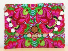 "Bright embroidered fabric with coin detail. Pop colored lining and interior pocketMeasurement 10 3/4"" x 8"""