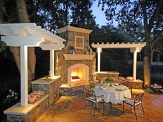 nice outdoor fireplace and dining area