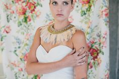 Wtoo wedding dress and feather bib necklace | http://burnettsboards.com/2013/12/9-unexpected-inspiring-bridal/