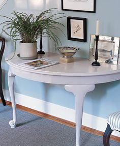 Make your own entry way table from vintage round/oval dinning table with extendable leaves, take off 1/2 of table, mount to wall!