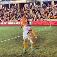 Brad Davis and Cam Weaver celebrating the Dynamo's goal against the Fire