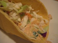 This fish taco recipe is awesome! I've tried it with tilapia and pangasius. Tilapia is much better. I cut it into 3-inch strips before adding the oil, sauce and lemon juice. Delicious!