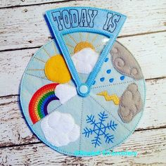 "Newest addition to the shop! Weather game for homeschool preschools! The top ""today"" piece spins around the bottom board letting kids pick the correct weather for the day. ""Today"" piece snaps on and off in case you want to look at all the weather wedges at once. #handmade #handmadetoys #etsy #etsyshop #etsyfind #weather #preschool #homeschool #christmasgifts"