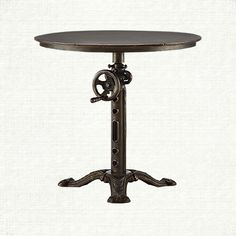 $599 An 18th century–inspired French industrial design. Our Kendall end table features a functioning crank to raise and lower the tabletop for anything yo