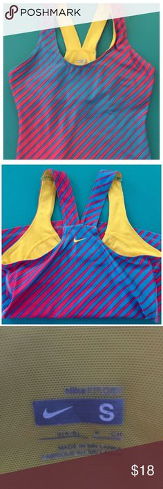 Nike Dri Fit work out tank. Nike Dri Fit work out tank. Barely used. Size small. Built in bra. Nike Tops Tank Tops