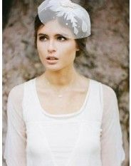 "Asimple, yet stunning ""Tulle Crown"" with floral embroidery detail. Petite and understated but very feminine."
