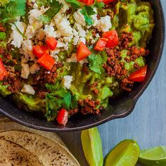Guacamole with Chorizo and Queso Fresco | This hearty guacamole can be served with tortilla chips or warm tortillas.