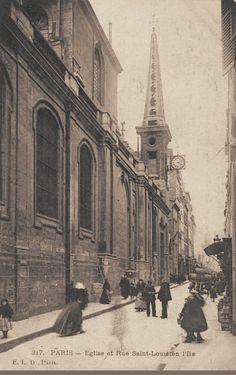 """L'ancien Hôtel Chemizot et sa belle porte, archevéché de Paris en 1848, rue Saint-Louis-en-l'Île, transformé en """"Garage Leboucher"""", vers 1900."""