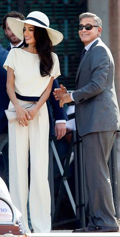 George Clooney and Amal Alamuddin in cream and black elegant afternoon dress with hat