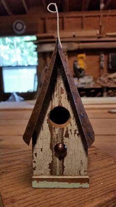 My little friend.  Ornament birdhouse created by Jefferson Garvey, Recycling is for the birds!