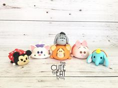 Tsum Tsum Rice Krispy Treats covered in fondant cake toppers - Eeyore, Minnie Mouse, Dumbo, Tigger, Pigglet, Marie