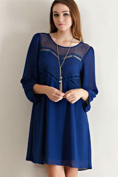 A Solid peasant dress featuring crochet lace detailing on yoke. Keyhole on back with button. Semi-sheer. Partially lined. Woven. Lightweight. Fabric: 100% polyester. Approx length from shoulder to hem: 33.5in. Loose, flowy fit.