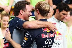 Sebastian Vettel Sebastian Vettel of Germany and Infiniti Red Bull Racing celebrates with Team Principal Christian Horner in the paddock after winning the Italian Formula One Grand Prix at Autodromo di Monza on September 8, 2013 in Monza, Italy.