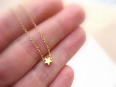 Dainty gold tiny star necklace, perfect for layering with other necklaces yet very beautiful as a stand alone piece
