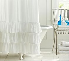 """1. Ruffle Shower Curtain — Pottery Barn $69 2. Sculpted Mums Shower Curtain — //www.anthropologie.com/anthro/product/home-bath/093742.jsp """">Anthropologie $118-128"""