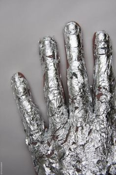silver flaking paint hand