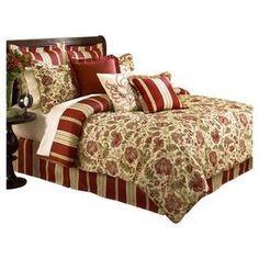 "Floral comforter set with striped accents.     Product: Queen: 1 Comforter, 1 bed skirt and 2 standard shamsKing: 1 Comforter, 1 bed skirt and 2 king shams   Construction Material: 100% Cotton    Color: Red, beige and sage   Features: Will enhance any bedroom décor  Dimensions:    Queen Comforter: 92 x 96       King Comforter: 110 x 96  Standard Sham: 20"" x 26"" eachKing Sham: 20"" x 36"" each   Cleaning and Care: Machine wash cold and tumble dry low"