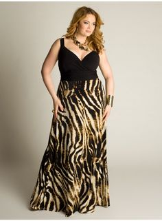 Naime Maxi Dress. The ultra-comfortable, boho maxi dress is updated with a bold, trend-perfect animal print with contrast bodice and curve defining Empire waistband. Pair with wedges and gold accessories for a sultry summer look. IGIGI by Yuliya Raquel. www.igigi.com