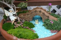 lots of adorable fairy gardens! Love the bridge!