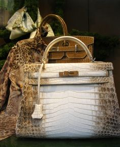 Hermès @}-,-;--