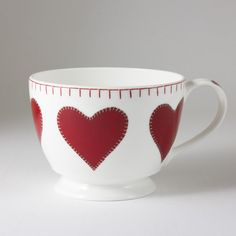 This gorgeous large cupped/breakfast style mug by Jan Constantine is decorated with our red heart appliqué design and the usual blanket-stitch effect trim. The mug holds 300ml and is made of high quality bone china that is suitable for dishwasher and microwave use.    Price     € 15.00