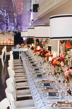 lamp centerpiece with flower accents - photo by Boyfriend Girlfriend http://ruffledblog.com/elegant-toronto-wedding-inspired-by-dolce-and-gabbana #weddingideas #reception #centerpieces
