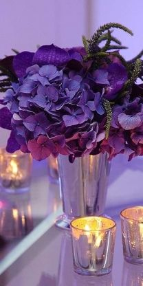 purple flowers and candles...lovely