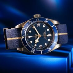 Sporty, yet elegant - The Tudor Heritage Black Bay Bronze Blue Bucherer BLUE mesmerises with its sporty look combined with the elegant bronze elements of the case, the blue dial, the iconic snowflake hand and the domed glass. Discover online now. Tudor Heritage Black Bay, Sporty Look, Tudor Black Bay Bronze, Omega Watch, Most Beautiful, Detail, Blue, Crown, Watches