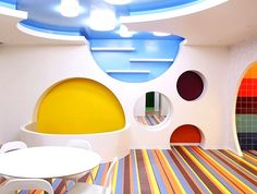 The room for visual arts focuses on curved organic shapes and vibrant colours