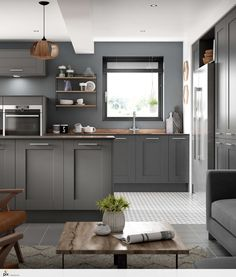 This on trend grey on grey shaker kitchen provides a great social living space whilst the functional kitchen design is key. Hints of woods, marbles, ceramics and copper in the worktop adds texture and character to the grown up contemporary design scheme. #interiordesign2018 #kitchendesign
