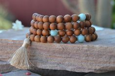 Check out this item in my Etsy shop https://www.etsy.com/listing/287471785/sandalwood-mala-beads-108-wrist-mala