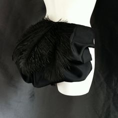 Black Taffeta Burlesque Bustle with Feathers- many colors and sizes available. $55.00, via Etsy.