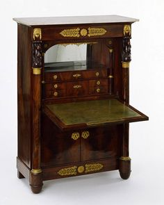 Writing desk. Mahogany veneered on oak, carved ornament, with chased and gilt mounts and marble top, Paris, c.1820.